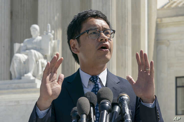 Dale Ho, an attorney for the American Civil Liberties Union, speaks to reporters after he argued before the Supreme Court against the Trump administration's plan to ask about citizenship on the 2020 census, in Washington, Tuesday, April 23, 2019. Critics say adding the question would discourage many immigrants from being counted, leading to an inaccurate count. (AP Photo/J. Scott Applewhite)
