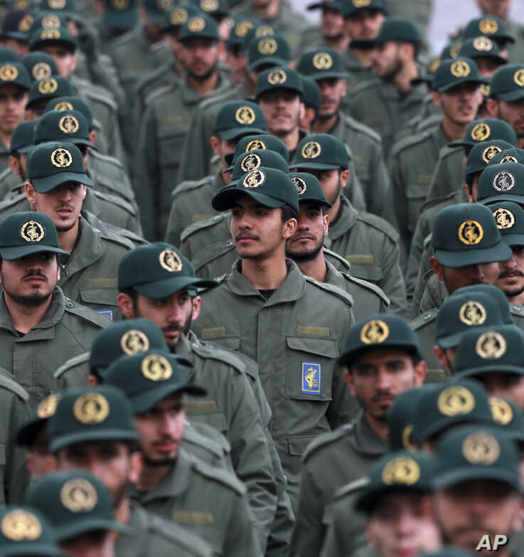 In this Feb. 11, 2019 file photo, Iranian Revolutionary Guard members attend a ceremony celebrating the 40th anniversary of the Islamic Revolution, at the Azadi, or Freedom, Square in Tehran, Iran.