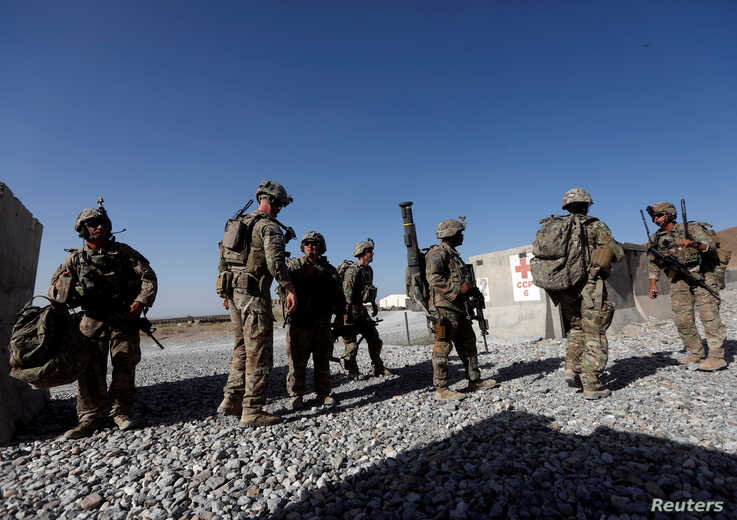 FILE - US troops wait for their helicopter flight at an Afghan National Army (ANA) Base in Logar province, Afghanistan.