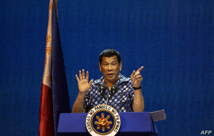 FILE - Philippine President Rodrigo Duterte gestures during the Partido Demokratiko Pilipino-LakasBayan (PDP-LABAN) meeting in Manila on May 11, 2019, ahead of Monday's the midterm elections.