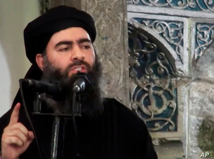 FILE -  This image made from video posted on a militant website July 5, 2014, purports to show the leader of the Islamic State group, Abu Bakr al-Baghdadi, delivering a sermon at a mosque in Iraq.