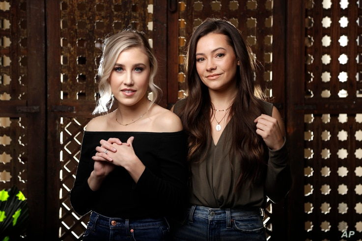 Madison Marlow, left, and Taylor Dye, of the duo Maddie & Tae, pose in Nashville, Tennessee, March 20, 2019.