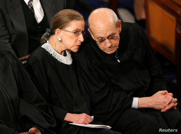 FILE - U.S. Supreme Court Associate Justices Ruth Bader Ginsburg and Stephen Bryer chat before then-President Barack Obama's address to a joint session of Congress on Capitol Hill in Washington, Feb. 24, 2009.