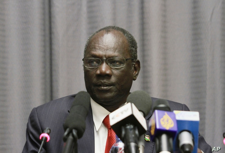 FILE - In this Jan. 5, 2014, file photo, South Sudanese Information Minister Michael Makuei attends a press conference in Addis Ababa, Ethiopia.