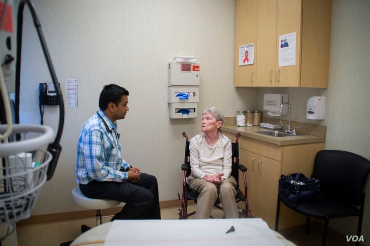 Dr. Raghav Tirupathi, an India-native physician, speaks with patient Elizabeth Jobes in Chambersburg, Pennsylvania.
