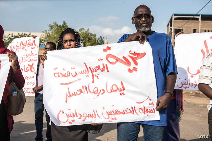 Khartoum journalists protest for press freedom in Sudan during sit-in.