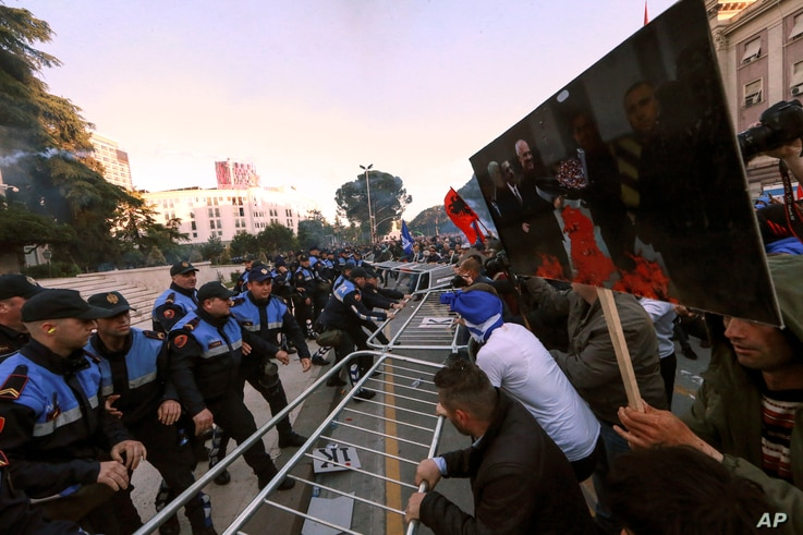 Protesters try to break a police cordon during an anti-government rally in Tirana, Albania, May 11, 2019. Protesters demand the Socialist government resign and call an early parliamentary election.
