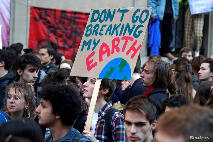 """Youths demonstrate for climate change during the """"Fridays for Future"""" school strike, in front of the Ecology Ministry in Paris, France, Feb. 15, 2019."""