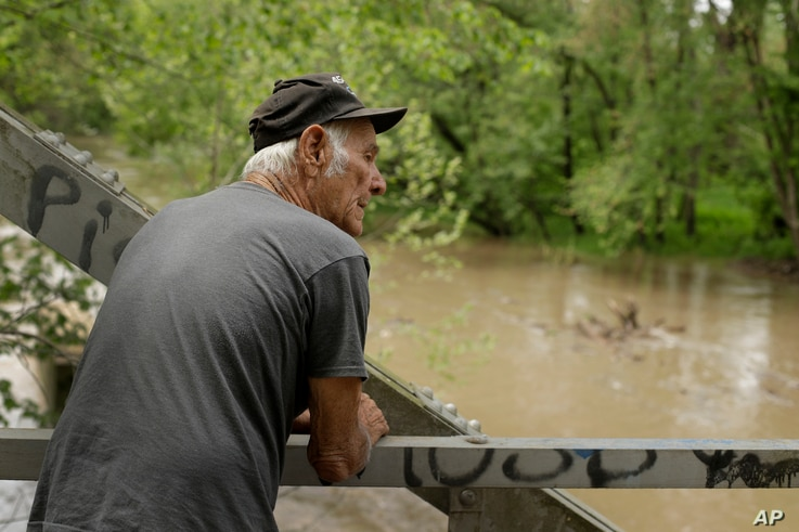 Elmer Sullivan checks out high water in the Fishing River in Mosby, Missouri, May 8, 2019.