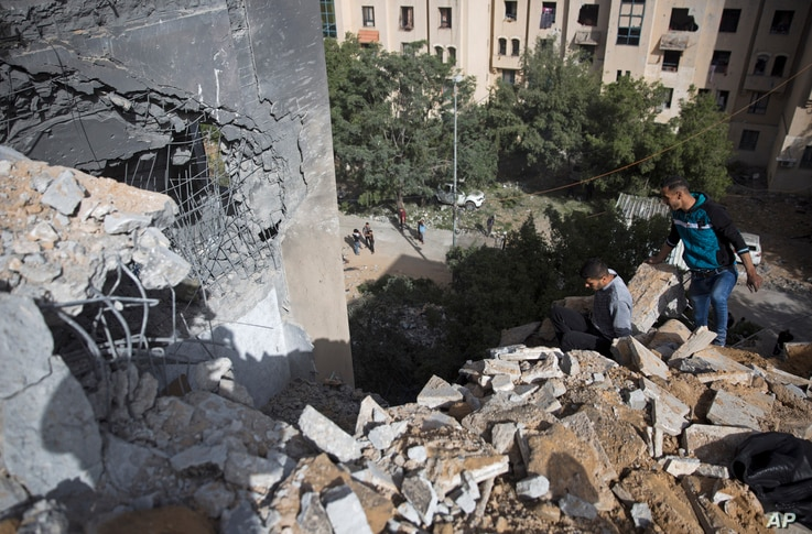 Palestinians inspect the damage of a destroyed house following a late night Israeli missile strike in town of Beit Lahiya, Northern Gaza Strip, May. 6, 2019.