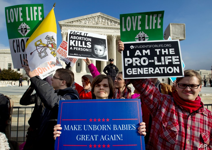 FILE - Anti-abortion activists protest outside of the U.S. Supreme Court, during the March for Life in Washington, Jan. 18, 2019.