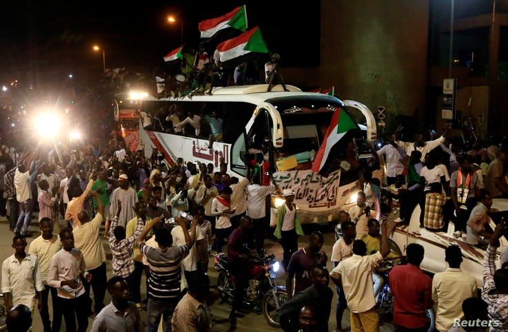 Sudanese demonstrators from the Darfur region chant slogans as they arrive to be part of a mass anti-government protest outside Defence Ministry in Khartoum, Sudan, April 30, 2019.