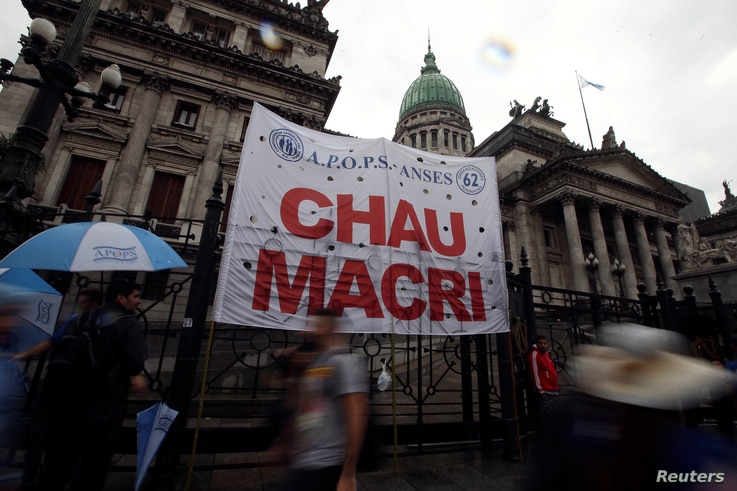 "Argentine unions, small firms and activists gather outside Argentina's Congress to demand changes in President Mauricio Macri's economic policies, in Buenos Aires, Argentina, April 4, 2019. The banner reads ""Bye Macri."""