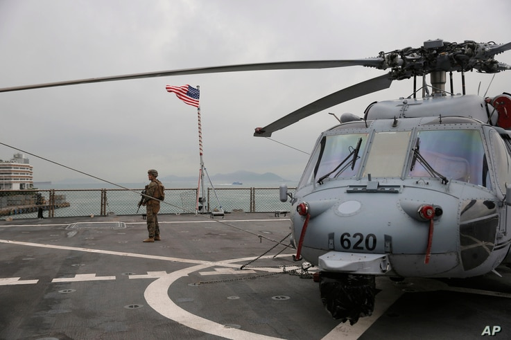 In this April 20, 2019, file photo, a U.S. marine patrols on the deck of the USS Blue Ridge, flagship of the U.S. Seventh Fleet, during a port call in Hong Kong, Saturday, April 20, 2019.
