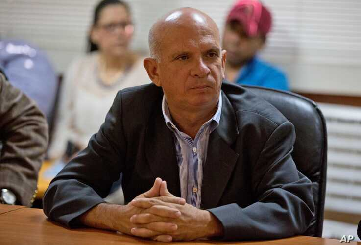 On Jan. 20, 2016, United Socialist Party of Venezuela lawmaker Hugo Carvajal attends a meeting at the National Assembly administrative offices, in Caracas, Venezuela.