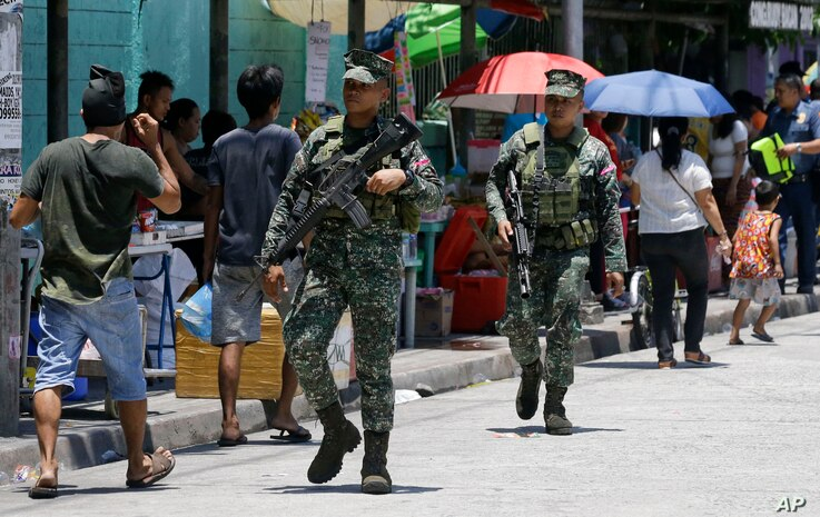 Philippine Marines secure a polling center during the country's midterm elections in Manila, Philippines on Monday, May 13, 2019.