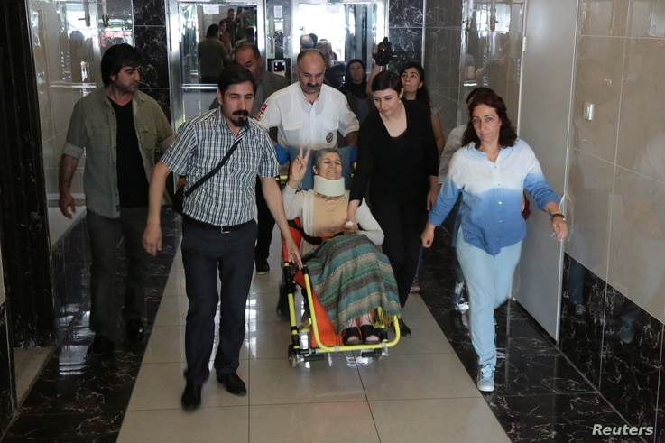 Pro-Kurdish Peoples' Democratic Party (HDP) lawmaker Leyla Guven, who ends her hunger strike after a call from jailed militant leader Abdullah Ocalan, leaves her home to go to hospital in Diyarbakir, May 26, 2019.