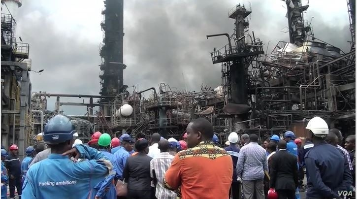 Government officials visit the refinery in Limbe, Cameroon, June 2, 2019, in the aftermath of an explosion that destroyed the facility over the weekend. (M. Kindzeka for VOA)