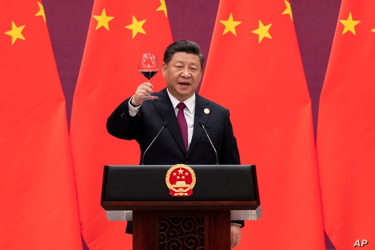 Chinese President Xi Jinping raises his glass and proposes a toast during the welcome banquet, after the welcome ceremony of visiting leaders attending the Belt and Road Forum at the Great Hall of the People in Beijing, April 26, 2019.