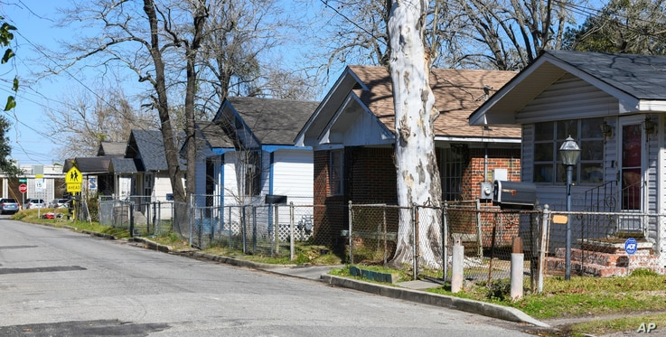FILE - Homes line Richardson Drive in Africatown in Mobile, Ala., established by the last boatload of Africans abducted into slavery and shipped to the United States just before the Civil War, Jan. 29, 2019.