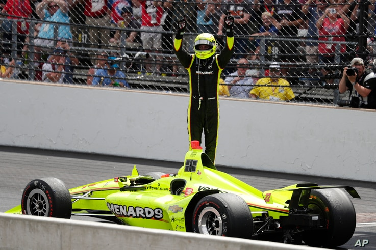 Simon Pagenaud, of France, celebrates after winning the Indianapolis 500 IndyCar auto race at Indianapolis Motor Speedway, Sunday, May 26, 2019, in Indianapolis.