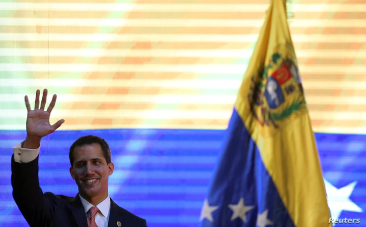 Venezuelan opposition leader Juan Guaido, who many nations have recognized as the country's rightful interim ruler, attends a forum to discuss a security plan for the country, in Caracas, Venezuela, April 11, 2019.