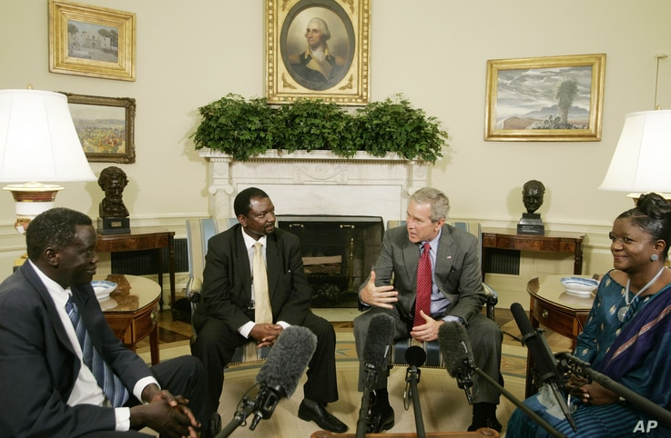 President Bush, second right, meets 2006 Democracy Award winners, from left to right: Alfred Taban of Sudan, Reginald Matchaba-Hove of Zimbabwe, and Zainab Bangura of Sierra Leone, in the Oval Office of the White House, June 27, 2006.