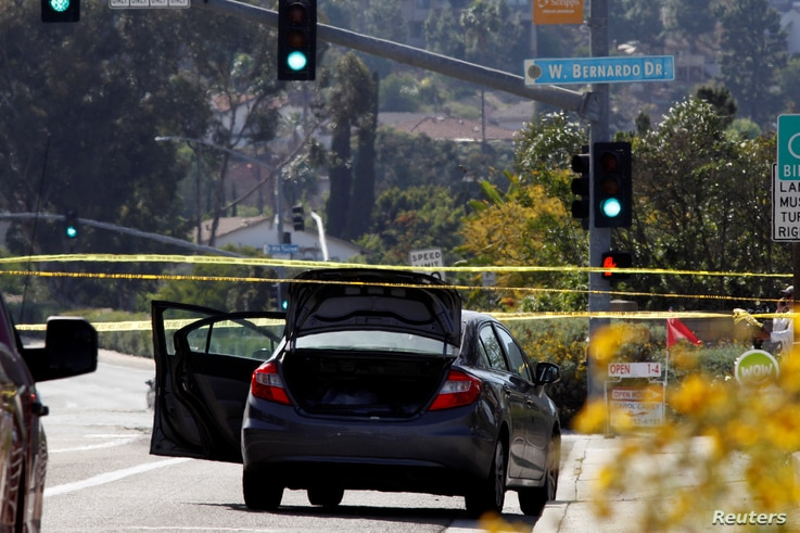 A car, allegedly used by the gunman who killed one at the Congregation Chabad synagogue in Poway, is pictured, few hundred feet from the Interstate 15 off-ramp north of San Diego, California, April 27, 2019.