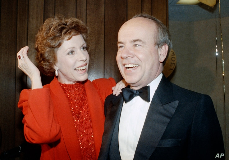 FILE - Carol Burnett, left, and veteran comrade in comedy Tim Conway laugh during a gala birthday party for Burnett in Los Angeles, April 26, 1986.