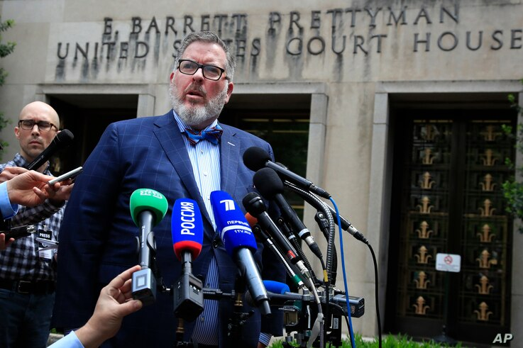 Robert Driscoll, Maria Butina's attorney, speaks to reporters outside the federal court in Washington, April 26, 2019, following the sentencing of his client. Butina, a Russian gun-rights activist, was sentenced to 18 months in prison on Friday after...
