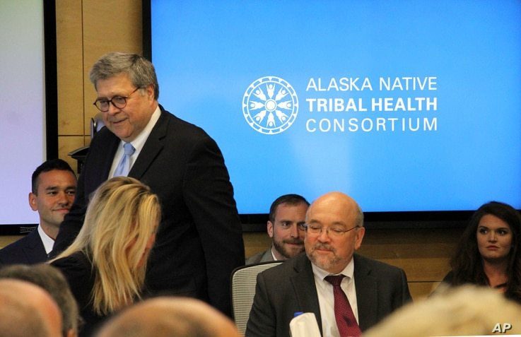U.S. Attorney General William Barr, standing, greets participants at a roundtable discussion at the Alaska Native Tribal Health Consortium, May 29, 2019, in Anchorage, Alaska.