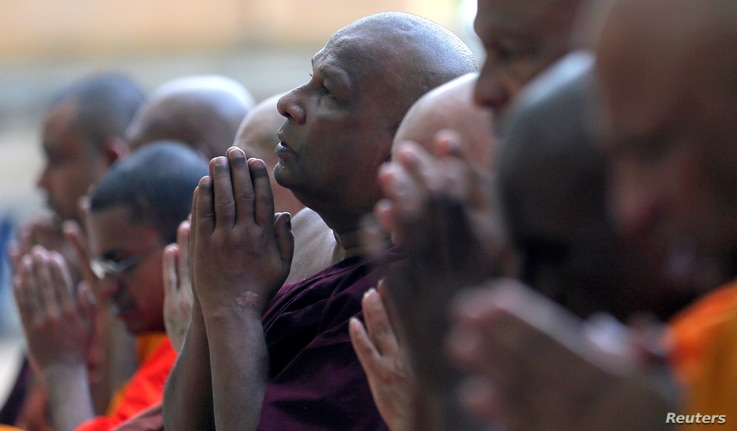 Buddhist monks take part in a prayer ceremony at a buddhist temple for the victims, three days after a string of suicide bomb attacks on churches and luxury hotels across the island on Easter, in Colombo, Sri Lanka, April 24, 2019.