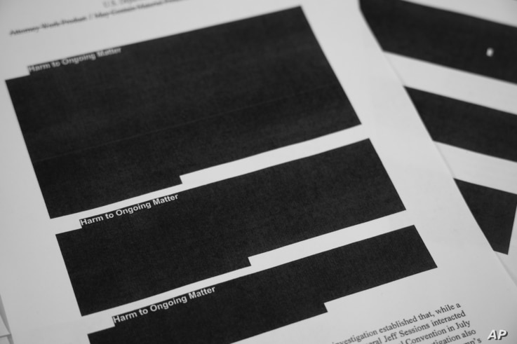 Special counsel Robert Mueller's report, with redactions, as released on Thursday, April 18, 2019, is photographed in Washington.