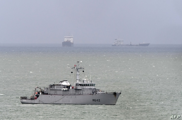 French navy minehunter ship Cassiopee, center, cruises off the cost of Le Havre harbor, Normandy, May 9, 2019, as the French government confirmed the day before that a new shipment of weapons will head for Saudi Arabia on the Saudi cargo ship Bahri Y...