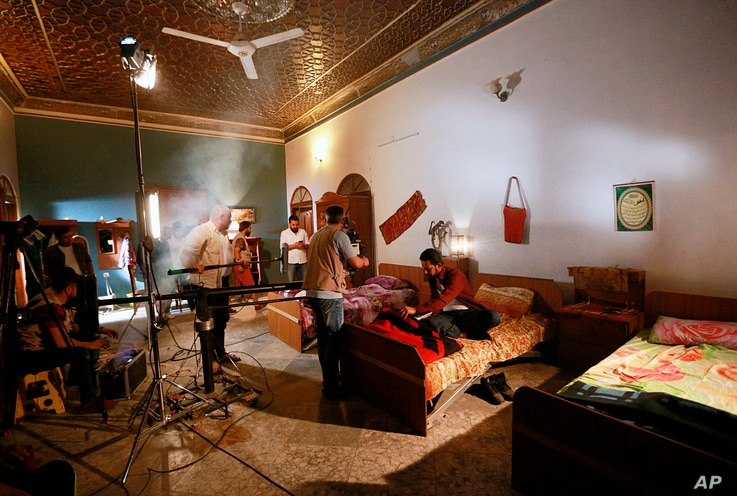 """Iraqi actors perform their roles in """"The Hotel,"""" at a filming location in Baghdad, April 26, 2019."""