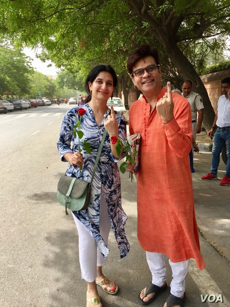 Many in India like this couple in New Delhi said that it is important to cast one's vote.