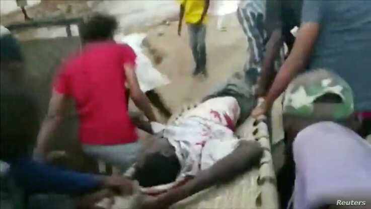 An injured man is carried on a stretcher during protests in Khartoum, Sudan, June 3, 2019 in this image taken from a video obtained from social media.