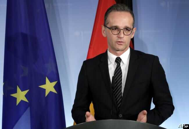 FILE - German Foreign Minister Heiko Maas addresses the media in Berlin, Germany, Nov. 27, 2018.