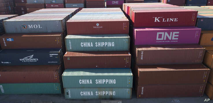 China Shipping Company containers are stacked at the Virginia International's terminal in Portsmouth, Va., May 10, 2019.