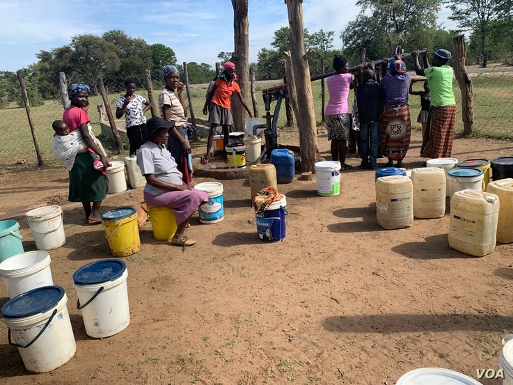 Nearly four decades after Zimbabwe's independence in April 1980, access to water remains an issue in the southern African nation. Here women in the Tsholotsho district about 600 km southwest of Harare, April 18, 2019, spend time at a borehole to ge...