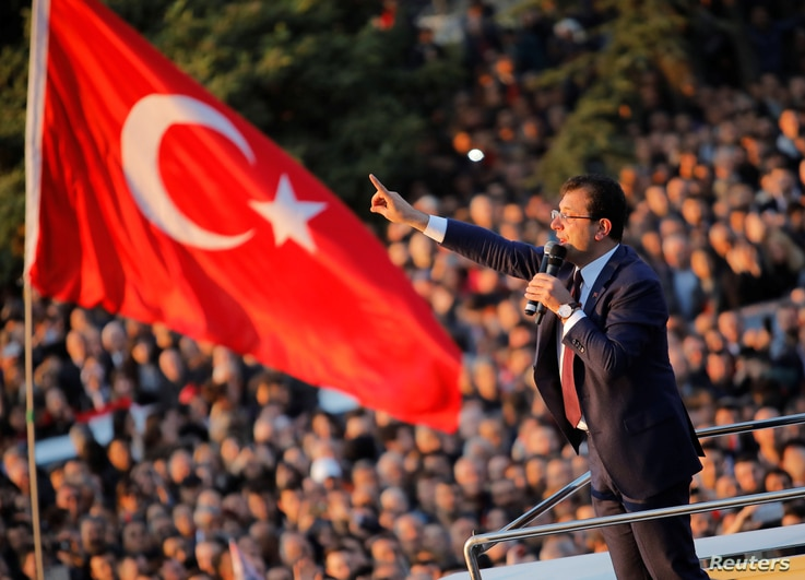 Newly elected Mayor of Istanbul Ekrem Imamoglu addresses his supporters outside the City Hall in Istanbul, Turkey, April 17, 2019.