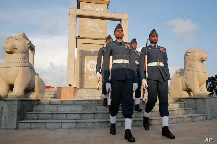 Sri Lankan soldiers march during the tenth anniversary of Sri Lanka's civil war victory at the national war heroes memorial in Colombo, Sri Lanka, May 19, 2019.