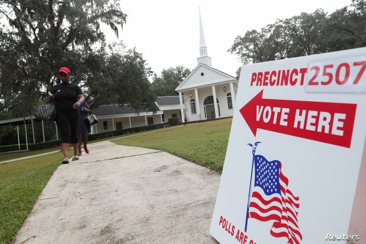 Voters leave a polling station during the midterm election in Tallahassee, Florida, Nov. 6, 2018.