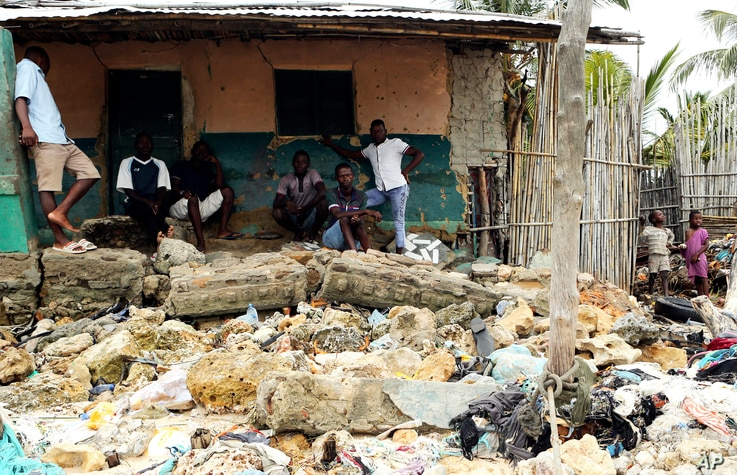 Community members look at rubble and other items washed close to their doorstep when Cyclone Kenneth struck in Pemba city on the northeastern coast of Mozambique, April, 27, 2019. Cyclone Kenneth arrived late Thursday, just six weeks after Cyclone Id...