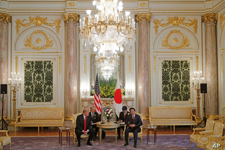 U.S. President Donald Trump, left, meets with Japanese Prime Minister Shinzo Abe at Akasaka Palace, Japanese state guest house in Tokyo, Monday, May 27, 2019.