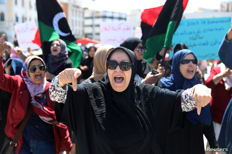 Libyan women shout slogans during a demonstration to demand an end to the Khalifa Haftar's offensive against Tripoli, at Martyrs' Square in Tripoli, Libya, April 17, 2019.