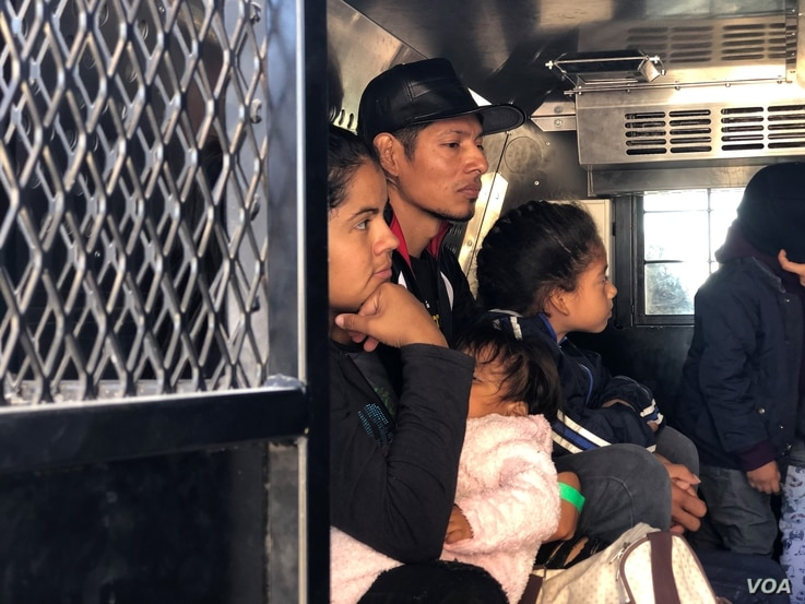 A group of Guatemalan migrants, including five families, waits inside a U.S. Customs Border Patrol truck after being processed at the crossing at El Paso, Texas, April 9, 2019. They said they walked from Ciudad Juarez, Mexico, and turned themselves i...