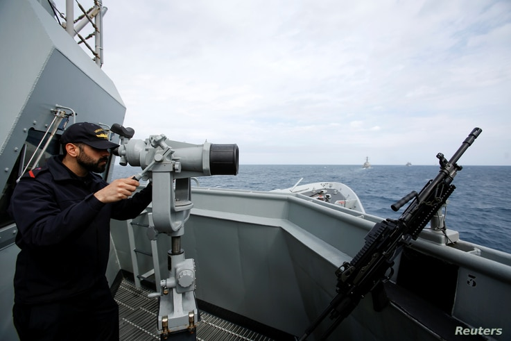 FILE - A crew member is seen on the deck of Spain's navy frigate Mendez Nunez as in participates in NATO exercises in the Mediterranean sea, March 13, 2017.