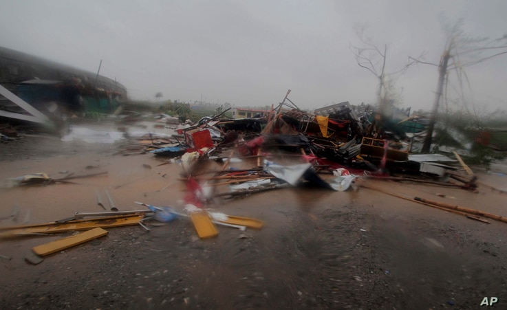 A road is littered with fallen structures in Puri district after Cyclone Fani hit the coastal eastern state of Odisha, India, May 3, 2019.