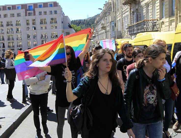 Georgian LGBT activists attend a rally against homophobia outside the State Chancellery to mark international day against homophobia